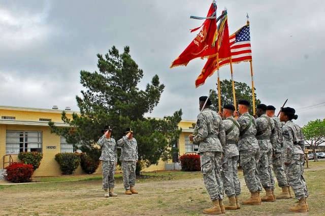 "Lt. Col. Richard Ng (far left), Tampa, Fla. native and commander of the 1st ""Dragon"" Battalion, 82nd Field Artillery Regiment, 1st ""Ironhorse"" Brigade Combat Team, 1st Cavalry Division and Command Sgt. Maj. Steven Rosales (second from left), the command sergeant major for the Dragon Battalion and Fresno, Calif. native, salute the national colors after their color guard received two unit streamers at an award ceremony March 28 at Fort Hood, Texas. The Dragon Battalion received the Meritorious Unit Commendation for ""exceptionally meritorious achievements"" during Operation New Dawn and the Army Superior Unit Award ""for outstanding meritorious service and outstanding performance"" while stationed at Fort Hood, according to the award citations given by the Army."