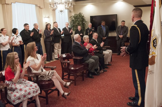 Lt. Col. David M. Krzycki recognizes family members, friends, and colleagues during his promotion ceremony to lieutenant colonel in the Pentagon's Patriot Room, 3 April 2013. Lt. Col. Krzycki, an Infantry Officer, is the current aide-de-camp to the Under Secretary of the Army.