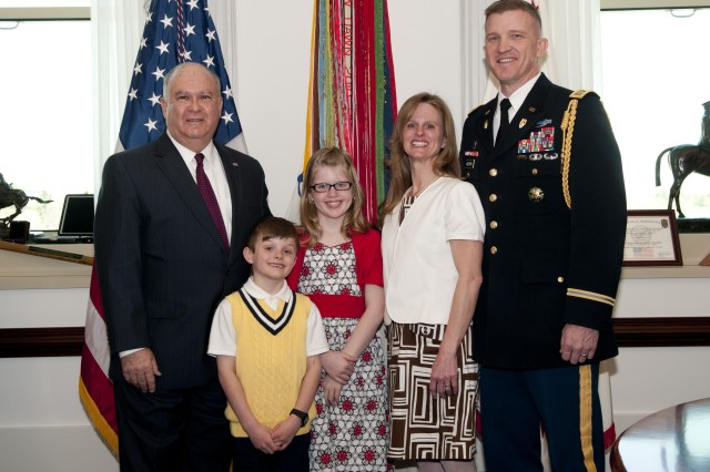Under Secretary Westphal congratulates the Krzycki family prior to David M. Krzycki's promotion ceremony to lieutenant colonel in the Pentagon's Patriot Room, 3 April 2013. Lt. Col. Krzycki, an Infantry Officer, is the current aide-de-camp to the Under Secretary of the Army. (From left to right: Under Secretary Joseph W. Westphal, Jackson Krzycki, Jordan Krzycki, Alicia Krzycki, and David M. Krzycki)
