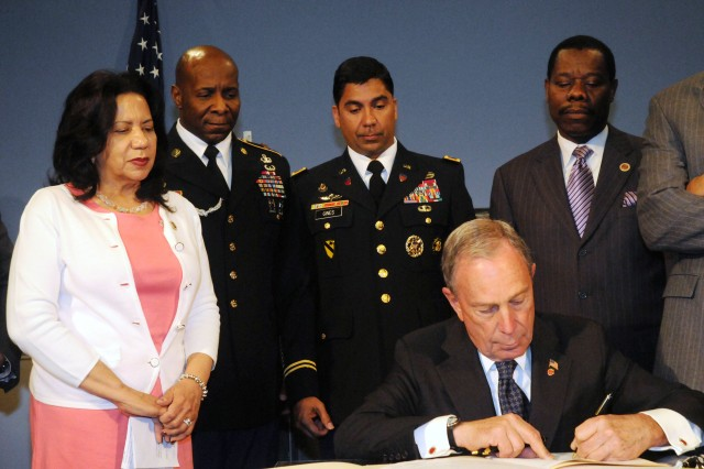 New York City Councilmember Sara M. Gonzalez invited Col. Eluyn Gines, commander of USAG Fort Hamilton, and Command Sgt. Maj. Hector Prince to join in witnessing Mayor Mike Bloomberg sign a local law accepting Veterans' military trade experience to grant New York City licenses and certifications, so that Veterans can more easily work in New York City in a trade they performed with the Army during a time of war. Council Member Mathieu Eugene, chair of the Committee for Veterans co-sponsored the legislation.