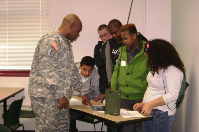 Sgt. 1st Class Vernon Walton, military evaluator, Command and Control Directorate, Army Evaluation Center, explains the Army coding system to students during Career Blast 2013 at Cecil College March 20.