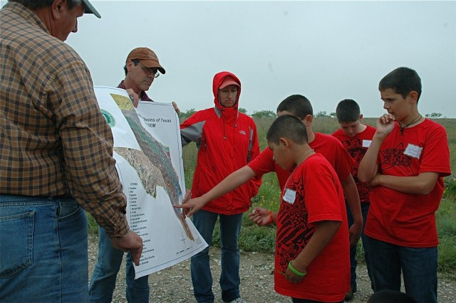Bryon Haney, a geospatial engineer for the Southwestern Division, talks to a group of fifth graders about watersheds, elevation model, water use and mapping in water cycle sessions on the ridge in Jack County between Brazos and Trinity Rivers. (Courtesy photo)