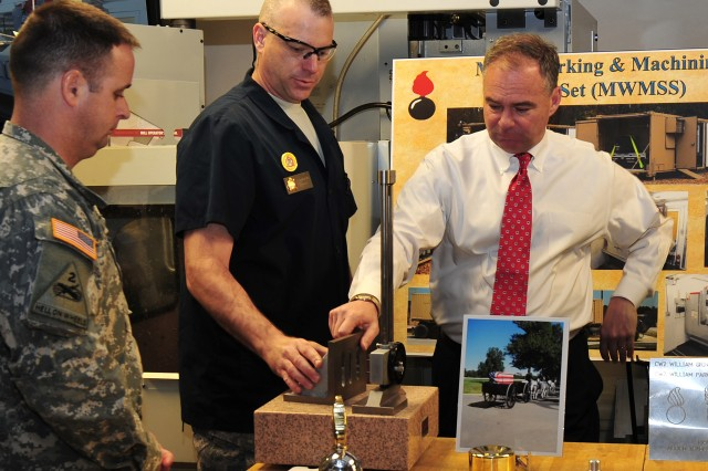 Chief Warrant Officer 4 Mark G. Davis, U.S. Army Ordnance School instructor, showed Senator Tim Kaine, Virginia, some of the products created by the computer aided design milling machines used in the Allied Trades Specialist course April 2. Kaine toured the Combined Arms Support Command to learn about the many credentialing opportunities available to sustainment Soldiers.