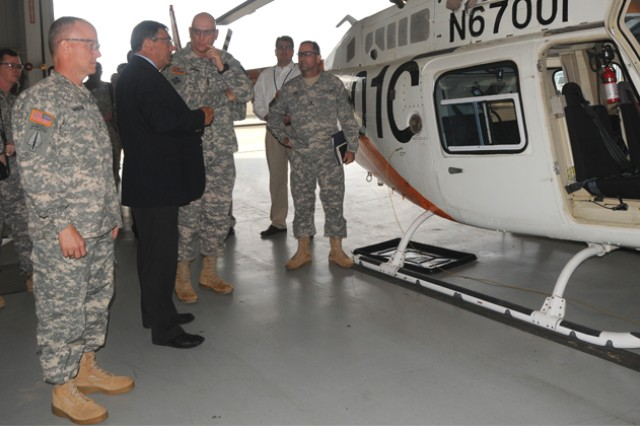 Chief of Staff of the Army Gen. Raymond T. Odierno receives a brief at the ACLC TH-67 maintenance facility during his visit to Fort Rucker, Ala., April 1, 2013.
