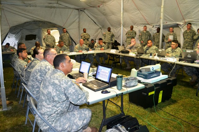Members of the 10th Regional Support Group's command team conduct a brief during a command post exercise (CPX) April 1st - 5th at Torri Station's Renegade Landing Zone.  The unit tested its abilities to conduct split based operations establishing mission command with a simulated natural disaster at Torii Station and Pacific Reach 13 Combined Joint Logistics on the Shore at Yokohama North Dock.  It's the first time the unit has executed a CPX since being redesignated as an RSG from an area support group (ASG) in 2010.