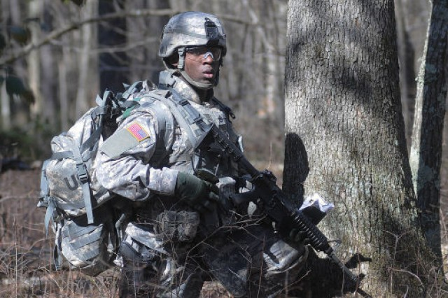 Staff Sgt. Shaun McKoy surveys the area after discoverying airdropped cargo during the U.S. Army Combined Support Command's Ultimate Warrior Competition April 2.  The Soldier skills event, held April 1-3, brought together 13 Soldiers representing subordinate elements in the categories of Soldier, noncommissioned Officer, instructor, retention NCO and advanced individual training platoon sergeant of the year.  The winners will advance to the U.S. Army Training and Doctrine Command competitions scheduled to be held sometime during the coming months.