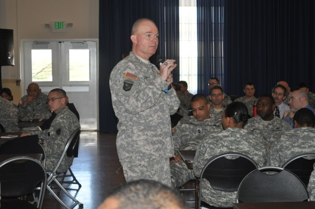 Sgt. Maj. David Stewart, senior enlisted advisor, Center for the Army Profession and Ethic, discusses the importance of the Profession of Arms Campaign with attendees during the Army Profession seminar held at the Aberdeen Proving Ground Recreation Center March 26, 2013.