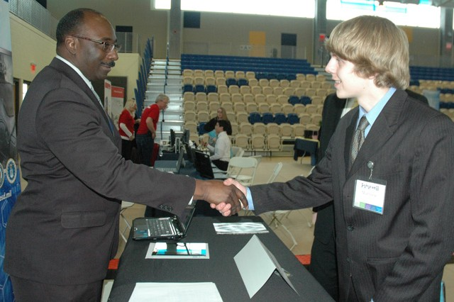 (From left) Steven Dean, from the Joint Program Executive Office for Chemical and Biological Defense, greets Matthew Gengenbach from Harford Technical High School during the fourth annual Futures 11 event at Harford Community College March 29.   During this event, students had a chance to attend workshops and network with science, technology, engineering and mathematics, or STEM, professionals, including several APG employees.