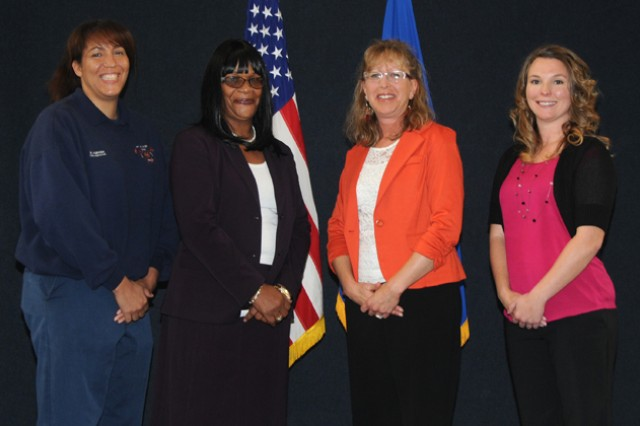 The winners of the 2013 Fort Rucker Women of the Year Award: Mary K. Hawkins, other category; Patsey Smith, technical category; Annette R. Styron, administrative category; and Candice S. Vaughan, professional category.