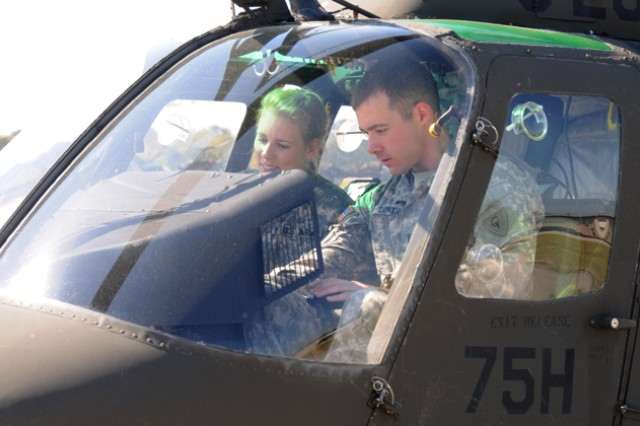 Flight students 2nd Lt. Jennifer MacGibbon, recent West Point graduate, and 1st Lt. Glenn Dorth, 2-238th General Support Aviation Battalion, Indiana National Guard, go over their pre-flight checklist in an OH-58 Kiowa at Shell Field March 29. MacGibbon and Dorth were among the first flight students to fly solo after the solo-flight incentives were re-instituted after 15 years.