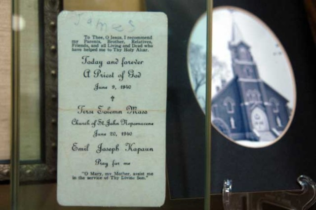 A prayer card from Father Emil Kapaun's first Mass, on display at Kapaun Mt. Carmel Catholic High School in Wichita, Kan. Just four years later, Kapaun would become a U.S. Army chaplain.