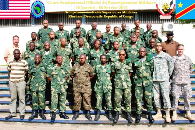 Students and instructors pose for the official class photo commemorating the conclusion of a three-week long Basic Intelligence course held at Groupement des Ecoles Supérieures Militaires or GESM near Kinshasa, Democratic Republic of the Congo. U.S. Army Africa's Lt. Col. Chris Dillard and Master Sgt. Frederick Blackburn along with Papa Sall and Garry Blood of Regional Joint Intelligence Training Facility, Molesworth, United Kingdom provided instruction for 29 personnel from the DRC's Armed Forces.
