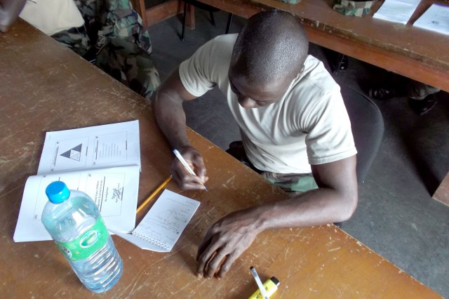 A bird's eye view of an Armed Forces of Liberia soldier working on a class assignment during a familiarization class on Inspector General operations event conducted by U.S. Army Africa's Capt. James Watson and Sgt. 1st Class Bobby Conn recently.