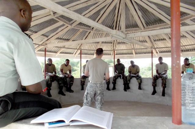 U.S. Army Africa's Capt. James Watson leads a discussion under in an open gazebo. Watson and Sgt. 1st Class Bobby Conn recently conducted a week-long familiarization class on Inspector General operations with 18 officers and NCOs of the Armed Forces of Liberia. The gazebo offered some relief from classroom temperatures that often exceeded 90 degrees Fahrenheit.