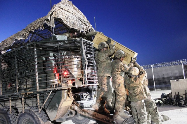 Soldiers from the Charlie Company, 2nd Battalion, 23rd Infantry Regiment, 4th Stryker Brigade Combat Team, unload supplies from one of 16Strykers at the Army Field Support Battalion-Kandahar, 401st Army Field Support Brigade, four corners location at Kandahar Airfield, Afghanistan, March 30. (Photo by Sharonda Pearson, 401st AFSB Public Affairs)