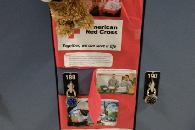 A bandaged teddy bear on Monty Schmid's locker highlights the Red Cross's life-saving mission.