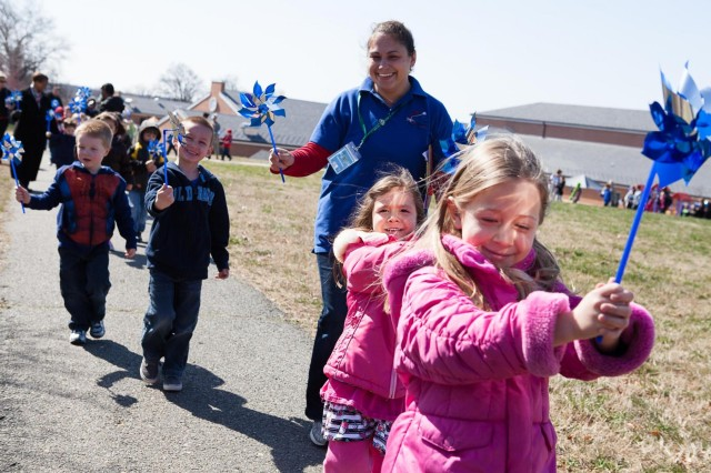 Children from the Cody Child Development Center, walk in the Pinwheel for Prevention parade on Joint Base Myer-Henderson Hall April 3. This is the second year children from the Cody CDC have walked in a parade for child abuse awareness.