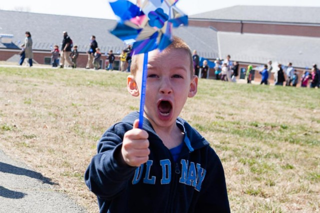 Jacob Huth, 5, from the Cody Child Development Center, walks in the Pinwheel for Prevention parade.