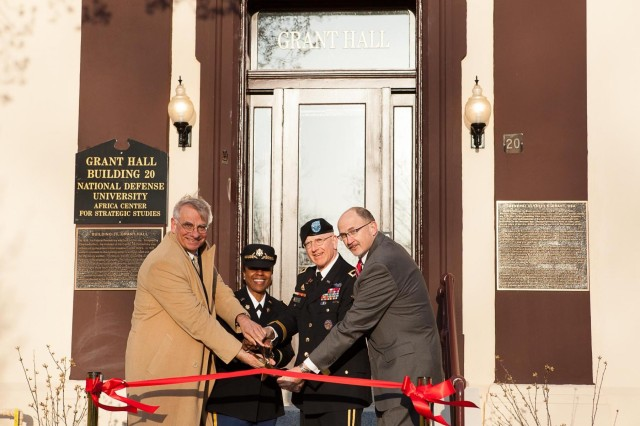 From the left: Senior Fellow Johns Hopkins University PH Nitze School of Advanced International Studies, Joint Base Myer-Henderson Hall Commander Col. Fern O. Sumpter, National Defense University President Maj. Gen. Gregg F. Martin and Acting Director Africa Center for Strategic Studies Michael Garrison cut the ceremonial ribbon during the dedication of Ulysses S. Grant Hall on the Fort Lesley J. McNair portion of Joint Base Myer-Henderson Hall, Va., April 3, 2013. The third floor of Grant Hall is the courtroom where Abraham Lincoln's assassination conspirators' trial took place and has been renovated to depict what the courtroom would have looked like in 1865.