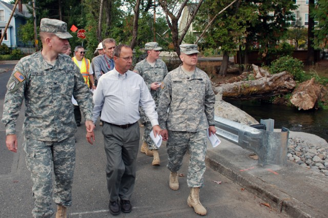 Portland District commander Col. John Eisenhauer (left) and project manager Jim Adams show Northwestern Division commander Brig. Gen. Anthony Funkhouser (pictured as a Colonel before his promotion) the Westmoreland Restoration Project in Portland, Ore.