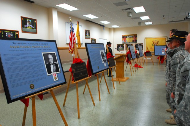 Soldiers stand at attention after the plaques bearing six Cavalry heroes' names were unveiled March 27 at Wheelock Hall on Harmony Church.