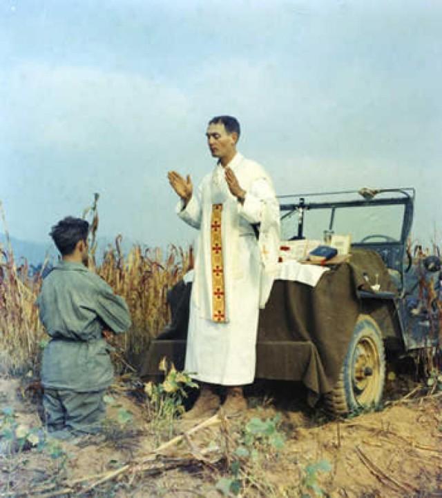 Father Kapaun celebrating mass jeepside
