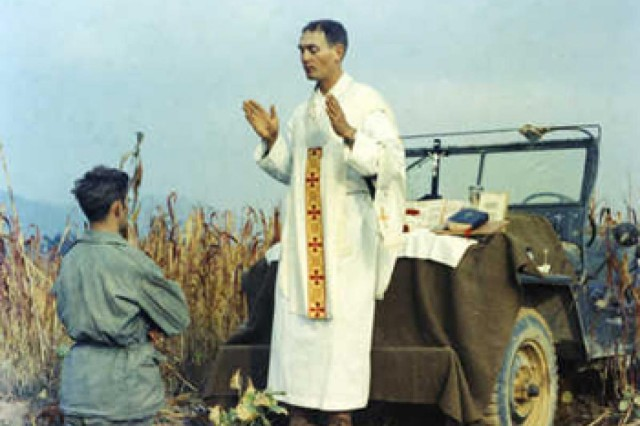 Chaplain (Capt.) Emil Kapaun celebrating Mass during the Korean War using the hood of a Jeep as his altar, Oct. 7, 1950. Less than a month later, Kapaun would, without regard for his own life, save a fellow Soldier from certain death.