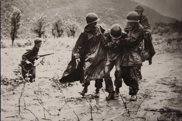 Kapaun carries a soldier