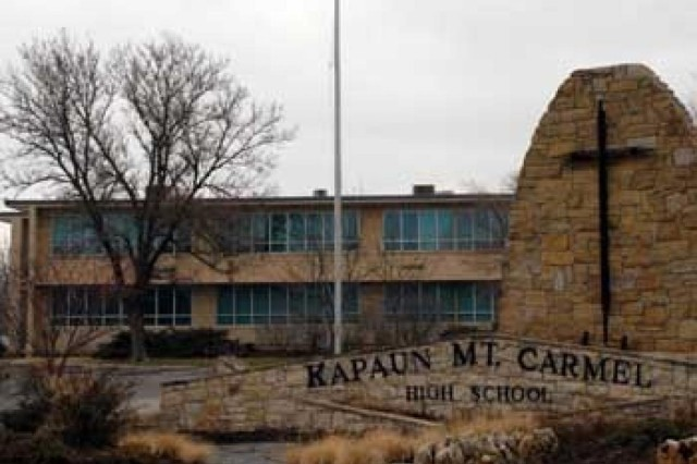 Kapaun Mount Carmel Catholic High School in Wichita, Kan., is named after Chaplain (Capt.) Emil Kapaun. Some of Kapaun's personal effects are on display in the school's lobby.