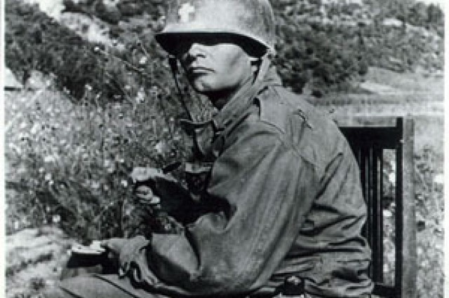 Chaplain (Capt.) Emil Kapaun writing a letter in Korea, circa 1950. During his Army service in World War II and the Korean War, Kapaun was a prolific letter writer. He was often seen writing home or writing letters of condolence to the families of fallen Soldiers.