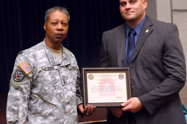 "FORT SAM HOUSTON, Texas "" Maj. Gen. Adolph McQueen, Jr., deputy commanding general for support, U.S. Army North (Fifth Army), stands with Special Agent Kyle Kennedy, who works at the Fort Sam Houston Criminal Investigation Department, April 3 after presenting him with a certificate of appreciation for his sensitivity and diligence in investigating sexual assault cases during the installation's Sexual Assault Awareness Month observance at the Warrior and Family Services building."