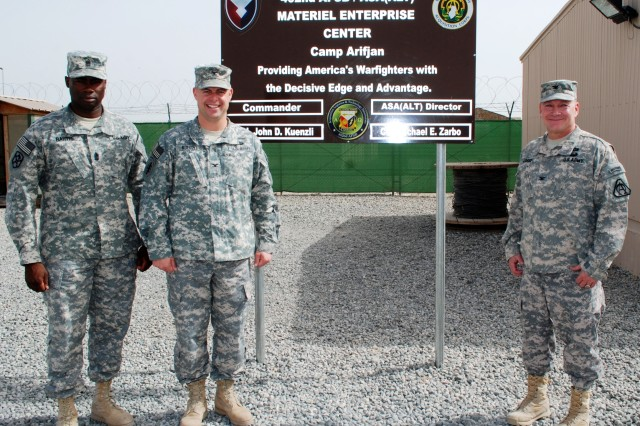 Command Sgt. Maj. Nathaniel Bartee Sr. (left), 402nd Army Field Support Brigade, Col.  John Kuenzli, commander, 402nd Army Field Support Brigade, and Col. Michael Zarbo (right), director of Acquisition, Logistics and Technology gather in front of the new Materiel Enterprise Center sign during a ribbon cutting ceremony marking the opening of the 402nd AFSB/ASA (ALT) Materiel Enterprise Center March 13 at Camp Arifjan, Kuwait. (Photo by Johnnie Frazier, 402nd AFSB Public Affairs)