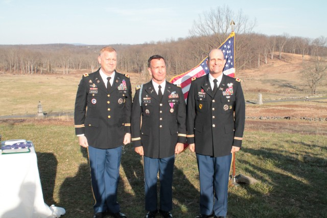 Col. Jim Brundage, left, Lt. Col. Brian De Toy, center, and Col. Tim Vuono, right, pose at the conclusion of De Toy's retirement ceremony at Gettysburg National Military Park, Pa., April 6, 2013.  Cadets from West Point's defense and strategic studies program attended the ceremony during their staff ride to battlefield. (U.S. Army photo/released)