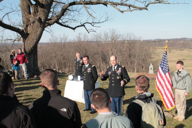Col. Tim Vuono, right, provides remarks in front of cadets during Lt. Col. Brian De Toy's, center, retirement ceremony at Gettysburg National Military Park, Pa., April 6, 2013. Cadets from West Point's defense and strategic studies program attended the ceremony during their staff ride to battlefield. (U.S. Army photo/released)
