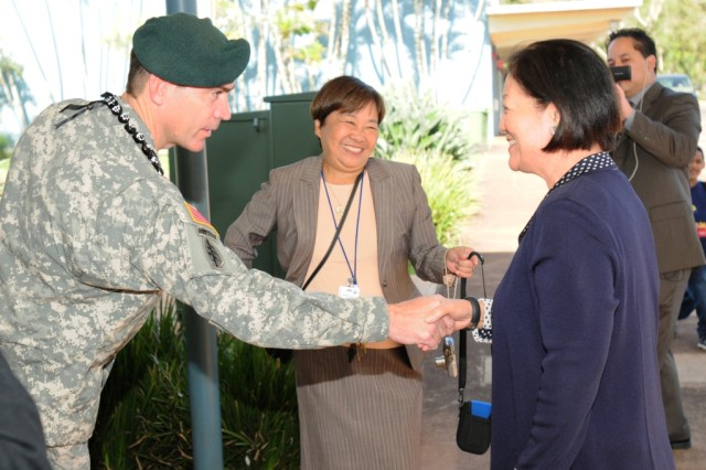Col. Daniel W. Whitney, the U.S Army Garrison-Hawaii commander, greets U.S. Senator Mazie Hirono during a visit to Schofield Barracks, Hawaii, April 3, 2013.