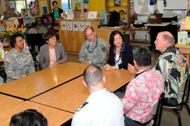 Col. Daniel W. Whitney, the U.S Army Garrison-Hawaii, and U.S. Senator Mazie Hirono,  sit down and talk to faculty members of the Hale Kula Elementary School and family members during a recent visit to Schofield Barracks, Hawaii, April 3, 2013.