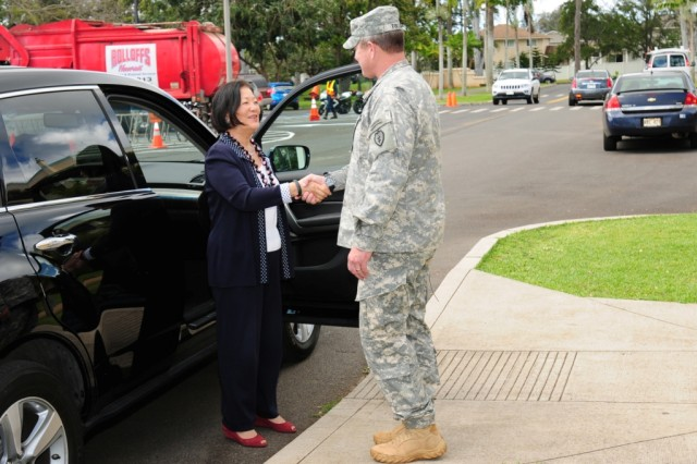 Maj. Gen. Kurt Fuller, commander, 25th Infantry Division, greets U.S. Senator Mazie Hirono during a recent visit to the 25th Ifantry Division headquarters on Schofield Barracks, Hawaii, April 3, 2013.