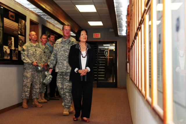 Maj. Gen. Kurt Fuller, commander, 25th Infantry Division gives a brief tour of the 25th ID Headquarters building to U.S. Senator Mazie Hirono during a visit to Schofield Barracks, Hawaii, April 3, 2013.