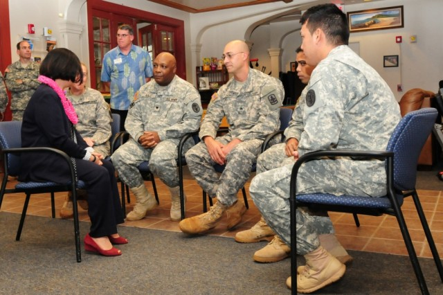 U.S. Senator Mazie Hirono, (left) speaks with Soldiers at the Warrior Transition Center on during a visit to Schofield Barracks, Hawaii, April 3, 2013. The Soldiers were able to talk one-on-one with the senator about their personal experiences while at the WTC.