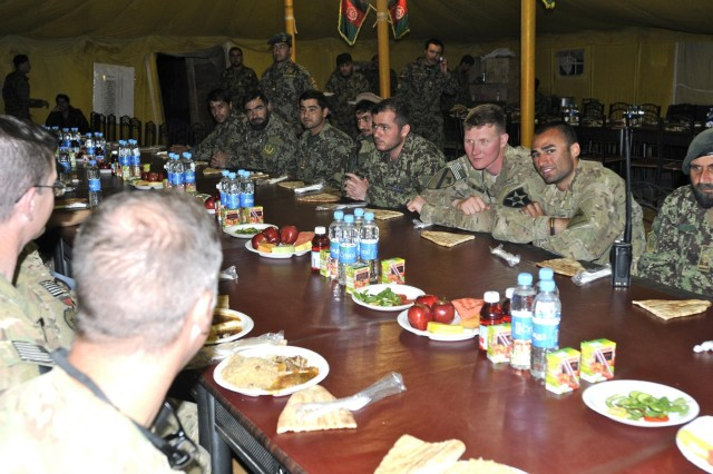 Afghan and US soldiers celebrate successful mission together during Nowruz dinner