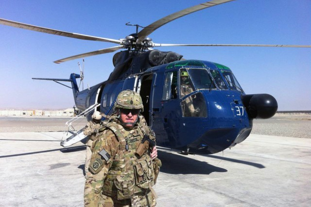 Command Sgt. Maj. Dave Sanborn, a Reservist, gets ready to board a helicopter at Bagram Airfield, Afghanistan, to visit with Soldiers at forward operating bases. In the civilian world, Sanborn is chief of Master Planning at U.S. Army Garrison Natick, Mass.