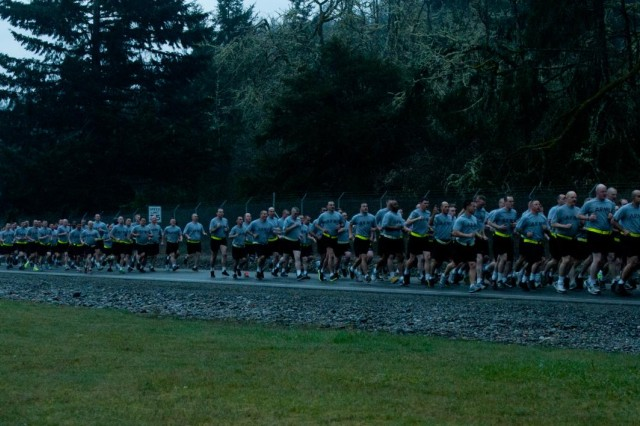 U.S. Soldiers assigned to the 3rd Brigade Combat Team, 2nd Infantry Division participate in a 3.6-mile run at Joint Base Lewis-McChord, Wash., March 28, 2013. The run commemorated the 18th anniversary of the unit's move to the installation.  (U.S. Army photo by Sgt. 1st Class Joshua Brandenburg/Released)