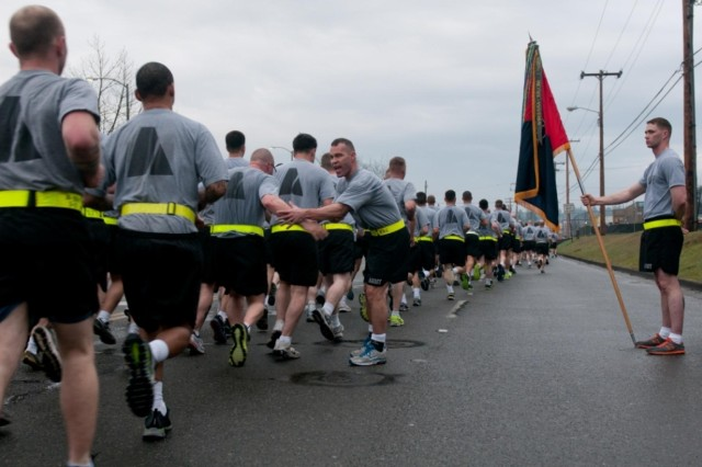 U.S. Army Col. Hugh Bair, center, the commander of the 3rd Brigade Combat Team, 2nd Infantry Division, greets his Soldiers as they finish a 3.6-mile brigade run at Joint Base Lewis-McChord, Wash., March 28, 2013. The run commemorated the 18th anniversary of the unit's move to the installation.  (U.S. Army photo by Sgt. 1st Class Joshua Brandenburg/Released)
