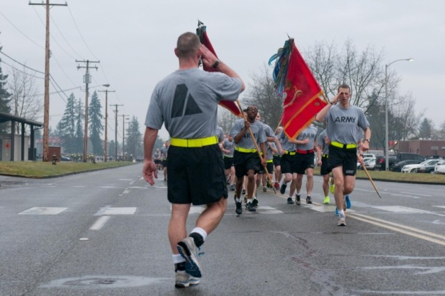 U.S. Army Col. Hugh Bair, left, the commander of the 3rd Brigade Combat Team, 2nd Infantry Division, salutes Lt. Col. Rory Crooks, the commander of the 1st Battalion, 37th Field Artillery Regiment, as he crosses the finish line of a 3.6-mile run with his Soldiers at Joint Base Lewis-McChord, Wash., March 28, 2013.  (U.S. Army photo by Staff Sgt. Joshua Brandenburg/Released)