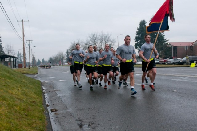 U.S. Army Col. Hugh Bair, front, the commander of the 3rd Brigade Combat Team, 2nd Infantry Division, and members of his staff, cross the finish line of a 3.6-mile run at Joint Base Lewis-McChord, Wash., March 28, 2013. The run commemorated the 18th anniversary of the unit's move to the installation.  (U.S. Army photo by Sgt. 1st Class Joshua Brandenburg/Released)