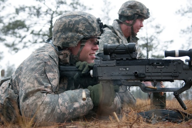 Sgt. Justin Lansford, a former infantryman with the 82nd Airborne Division's 2nd Battalion, 504th Parachute Infantry Regiment, fires an M240B machine gun with paratroopers of his old unit, Company D, during squad live-fire training March 24, 2013, at Fort Bragg, N.C.  Still convalescing from injuries sustained from an improvised explosive blast a year ago in Afghanistan, Lansford visited his old unit over a weekend to take part in their field training.  (U.S. Army photo by Sgt. Michael J. MacLeod)