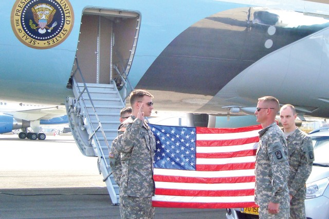Spc. Kurt Sanson reenlists next to Air Force One while deployed to Israel to support the president's visit.