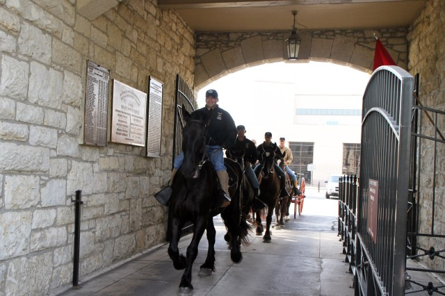 "FORT SAM HOUSTON "" Horses from the Caisson Section of the U.S. Army Military Honors Platoon, escort a replica of a 1870s Four-Mule Army Escort Wagon April 5 through the sally port of the historic Quadrangle. The wagon is the newest piece in the Fort Sam Houston Museum and is scheduled to go on display once the museum moves to the Quadrangle early 2014. It can be used by U.S. Army North (Fifth Army) during parades and other public events. This type of wagon was used by the Army to carry supplies from post to post and around post and was a common site at Fort Sam Houston 100 years ago."