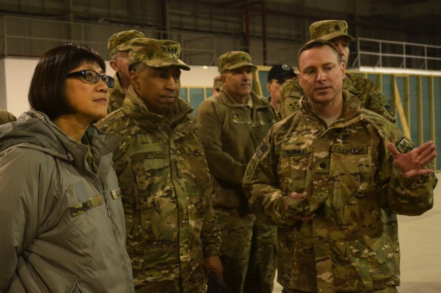 The Honorable Heidi Shyu, Assistant Secretary of the Army (Acquisition, Logistics & Technology), and Army Materiel Command commanding general, Gen. Dennis L. Via received a briefing from Lt. Col. Todd W. Burnley, commander, 3rd Battalion, 401st Army Field Support Brigade during their January 2013 visit to Bagram, Afghanistan facility. The leaders travelled to Afghanistan and Kuwait to view the progress of the ongoing retrograde of equipment. Via and Shyu held a follow-on meeting at Redstone Arsenal, Ala. last week to discuss progress with the retrograde mission, as well as other areas of concern.