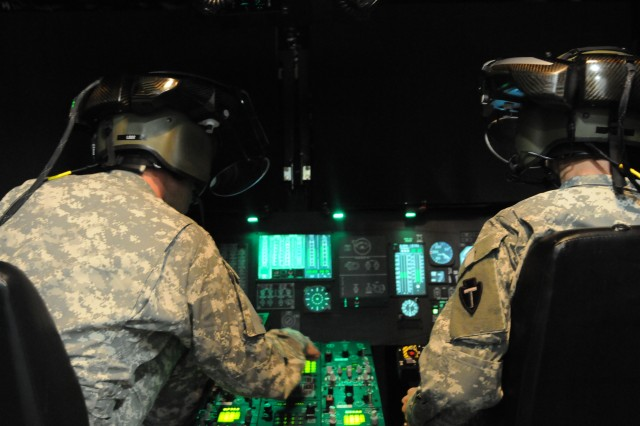 Soldiers of the Texas Army National Guard's 36th Combat Aviation Brigade operate the Aviation Combined Arms Tactical Trainer simulator as part of their post-mobilization training conducted by Division West's 166th Aviation Brigade at Fort Rucker, Ala., March 25, 2013. The Texas unit is training for a deployment to Kuwait.